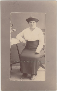 Serious Lady In Upturned Straw Hat pc1