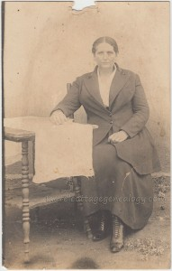 Woman Seated At Table pc1